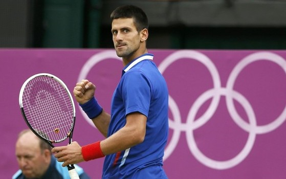 Serbia's Djokovic looks back afer making a point against Roddick of the U.S. in their men's singles tennis match at the All England Lawn Tennis Club during the London 2012 Olympic GamesREUTERS/Stefan Wermuth