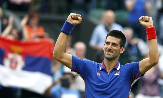 Serbia's Djokovic celebrates after winning his men's singles tennis match against Roddick of the U.S. at the All England Lawn Tennis Club during the London 2012 Olympic Games REUTERS/Stefan Wermuth